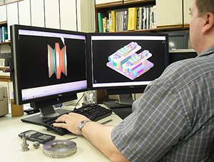 Man working on roll forming die design image